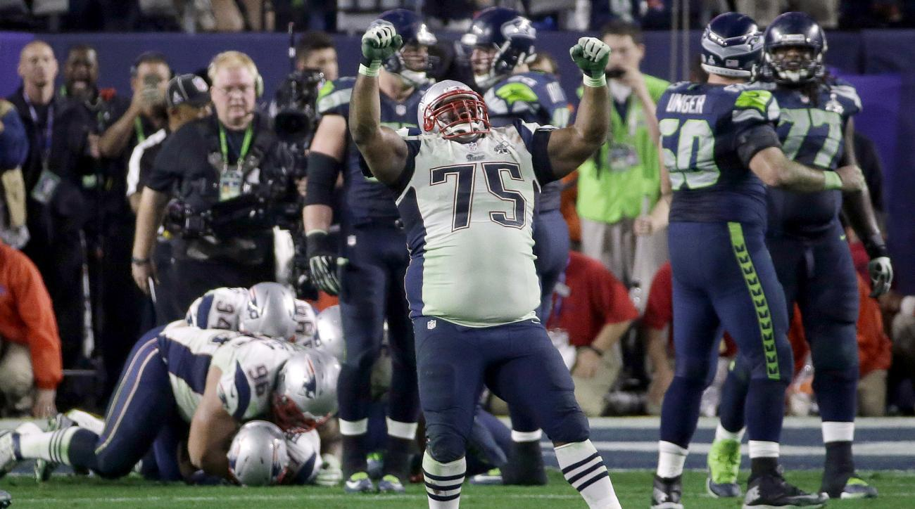 FILE - In this  Feb. 1, 2015, file photo, New England Patriots defensive tackle Vince Wilfork (75) celebrates after Malcolm Butler intercepted Seattle Seahawks quarterback Russell Wilson during the second half of NFL Super Bowl XLIX football game in Glend