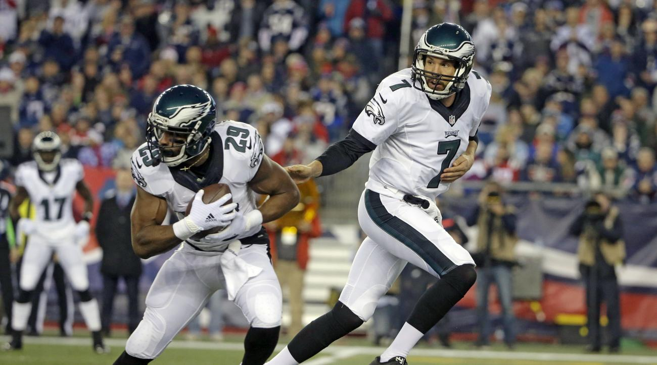 FILE - In this  Sunday, Dec. 6, 2015 file photo, Philadelphia Eagles quarterback Sam Bradford (7) hands off to running back DeMarco Murray (29) during the first half of an NFL football game against the New England Patrios in Foxborough, Mass. The 2014 NFL