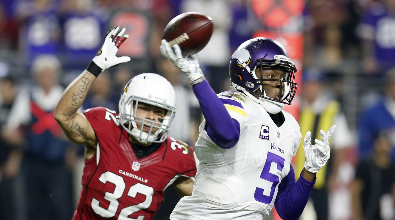 Minnesota Vikings quarterback Teddy Bridgewater (5) throws under pressure from Arizona Cardinals free safety Tyrann Mathieu (32) during the second half of an NFL football game, Thursday, Dec. 10, 2015, in Glendale, Ariz. (AP Photo/Rick Scuteri)