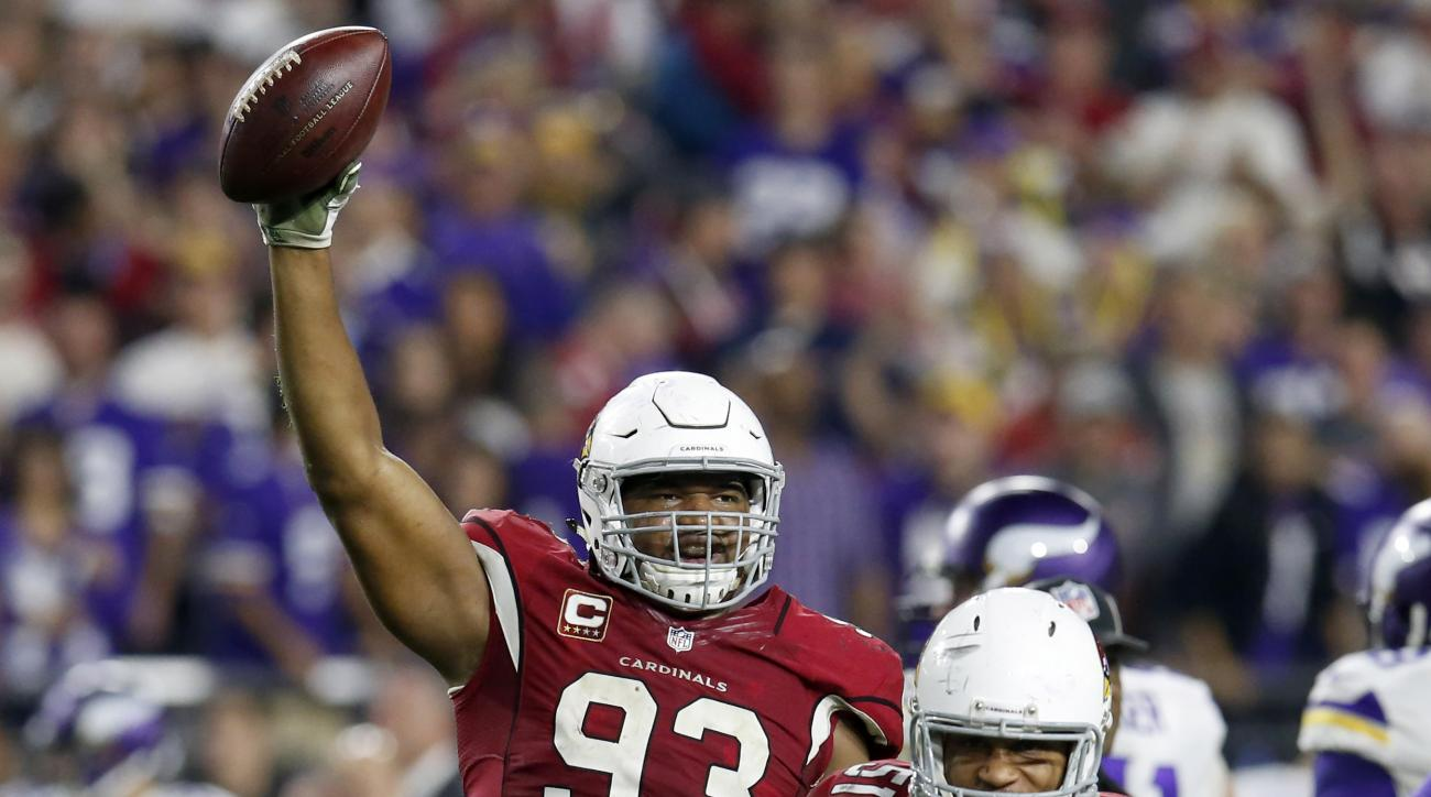 Arizona Cardinals defensive end Calais Campbell (93) holds up the football after a fumble recovery for the win against the Minnesota Vikings during the second half of an NFL football game, Thursday, Dec. 10, 2015, in Glendale, Ariz. The Cardinals won 23-2
