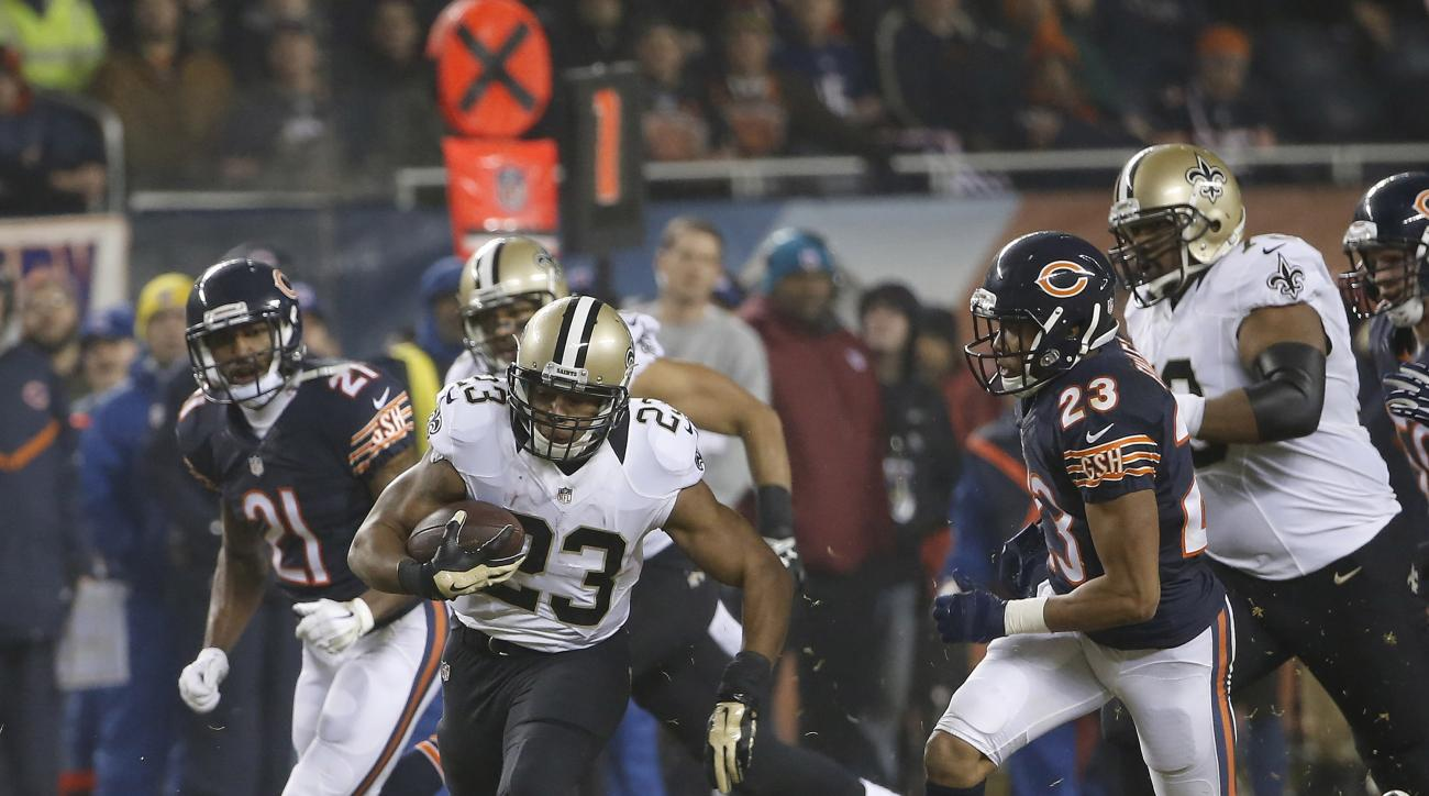 In this photo taken Dec. 15, 2014, then-New Orleans Saints running back Pierre Thomas (23) runs against the Chicago Bears during the first half of an NFL football game in Chicago. Thomas has signed with the Washington Redskins, whose ground game has been