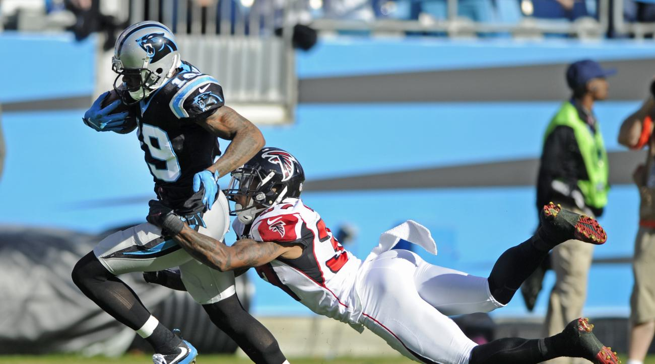 Carolina Panthers' Ted Ginn (19) breaks a tackle of Atlanta Falcons' Ricardo Allen (37) to run for a touchdown after a catch in the first half of an NFL football game in Charlotte, N.C., Sunday, Dec. 13, 2015. (AP Photo/Mike McCarn)