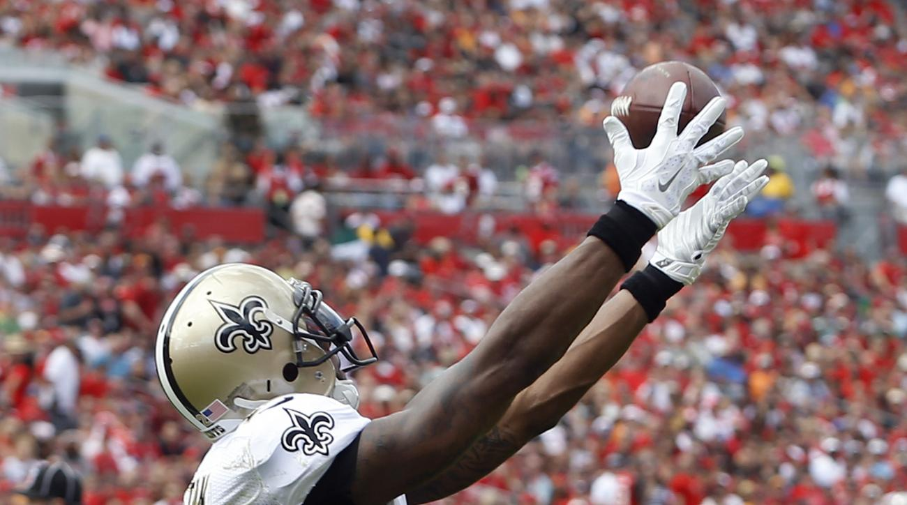 New Orleans Saints wide receiver Marques Colston (12) catches a 1-yard touchdown reception against the Tampa Bay Buccaneers during the second quarter of an NFL football game Sunday, Dec. 13, 2015, in Tampa, Fla. (AP Photo/Brian Blanco)