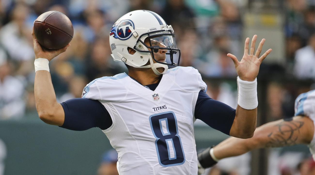 Tennessee Titans quarterback Marcus Mariota (8) throws a pass during the first half of an NFL football game against the New York Jets Sunday, Dec. 13, 2015, in East Rutherford, N.J.  (AP Photo/Julio Cortez)