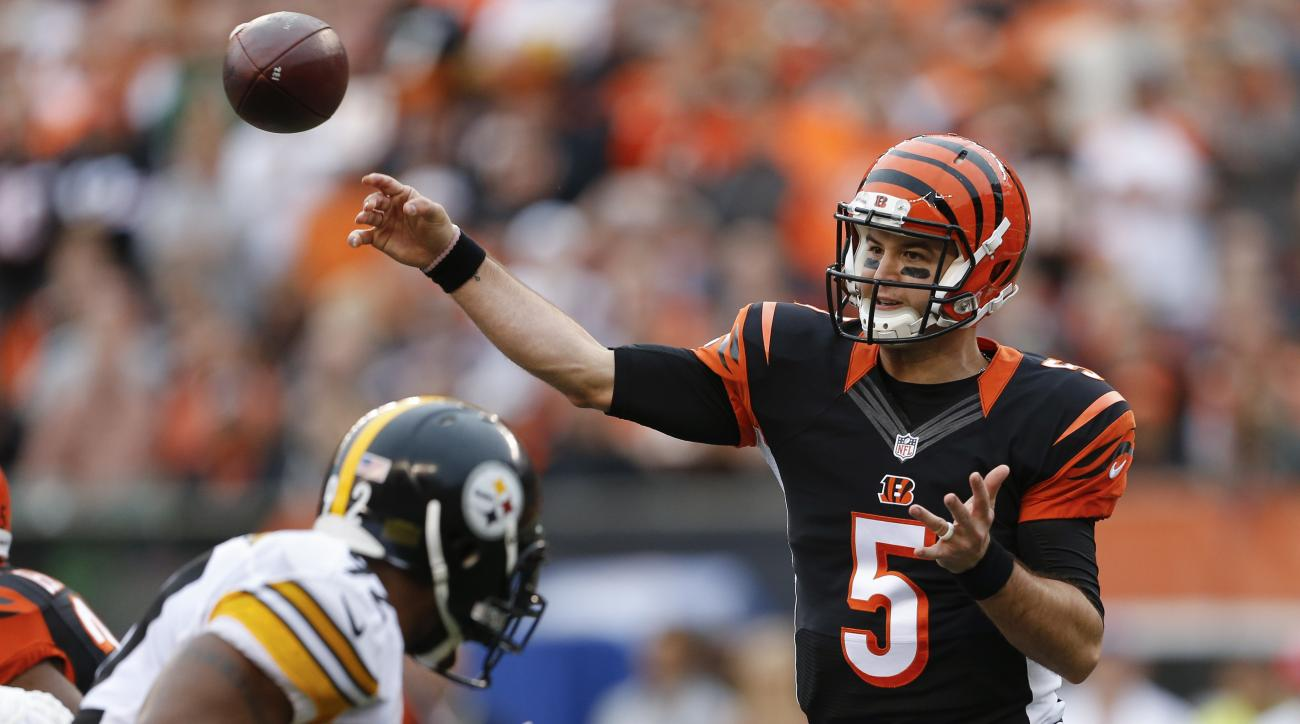Cincinnati Bengals quarterback AJ McCarron (5) throws in the first half of an NFL football game against the Pittsburgh Steelers, Sunday, Dec. 13, 2015, in Cincinnati. (AP Photo/Gary Landers)