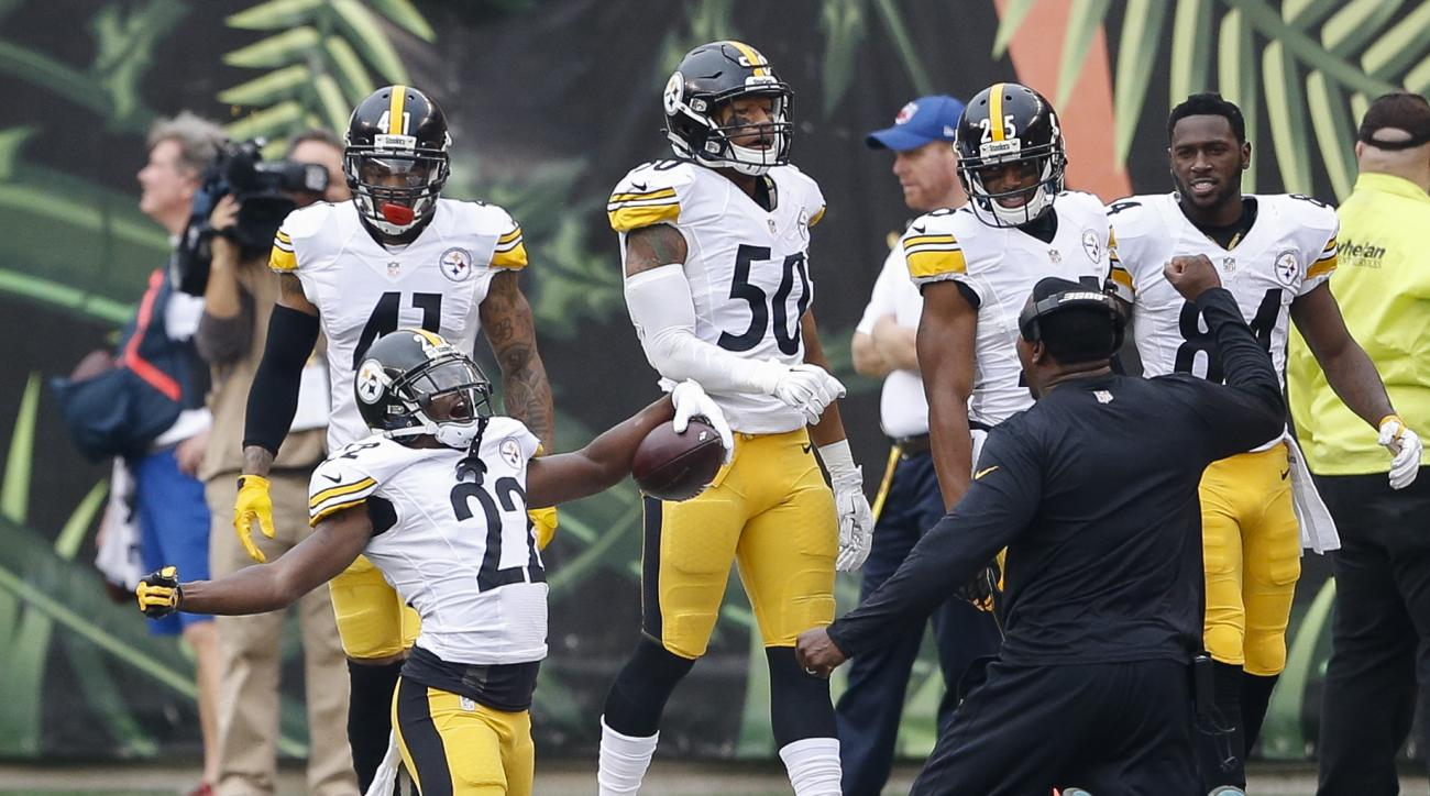 Pittsburgh Steelers cornerback William Gay (22) celebrates after scoring a touchdown on an interception off Cincinnati Bengals quarterback AJ McCarron (not shown) in the second half of an NFL football game, Sunday, Dec. 13, 2015, in Cincinnati. (AP Photo/