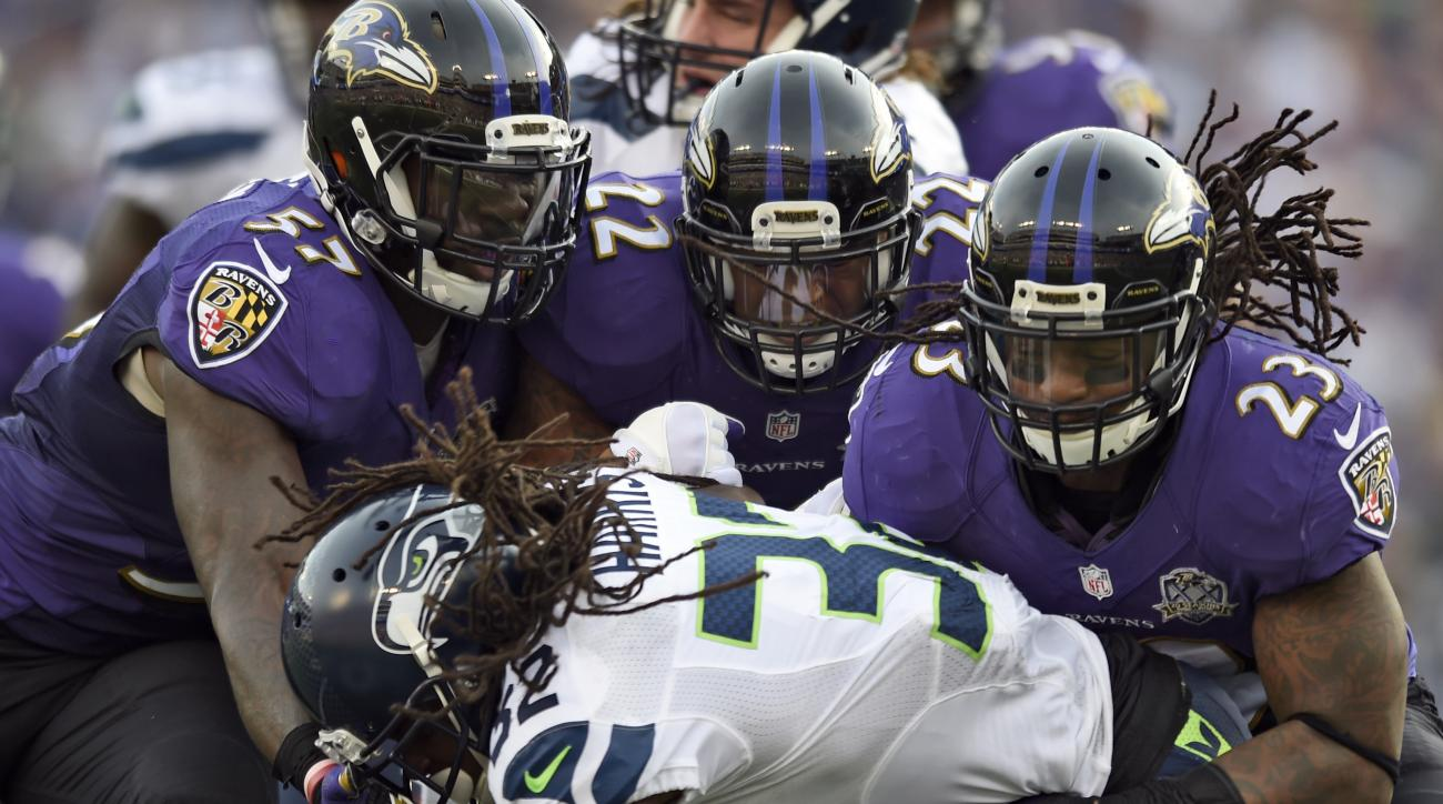 Seattle Seahawks running back DuJuan Harris (32) is tackled by Baltimore Ravens inside linebacker C.J. Mosley (57), Ravens cornerback Jimmy Smith (22) and Ravens free safety Kendrick Lewis (23) during the first half an NFL football game, Sunday, Dec. 13,