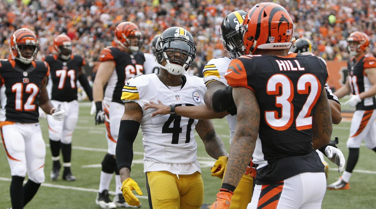 Pittsburgh Steelers cornerback Antwon Blake (41) confronts Cincinnati Bengals running back Jeremy Hill (32) in the first half of an NFL football game, Sunday, Dec. 13, 2015, in Cincinnati. (AP Photo/Frank Victores)