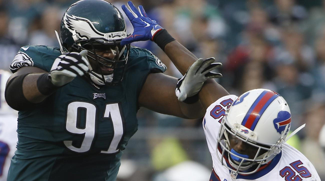 Buffalo Bills' LeSean McCoy, right, tries to avoid a tackle from Philadelphia Eagles' Fletcher Cox  during the second half of an NFL football game, Sunday, Dec. 13, 2015, in Philadelphia. (AP Photo/Matt Rourke)