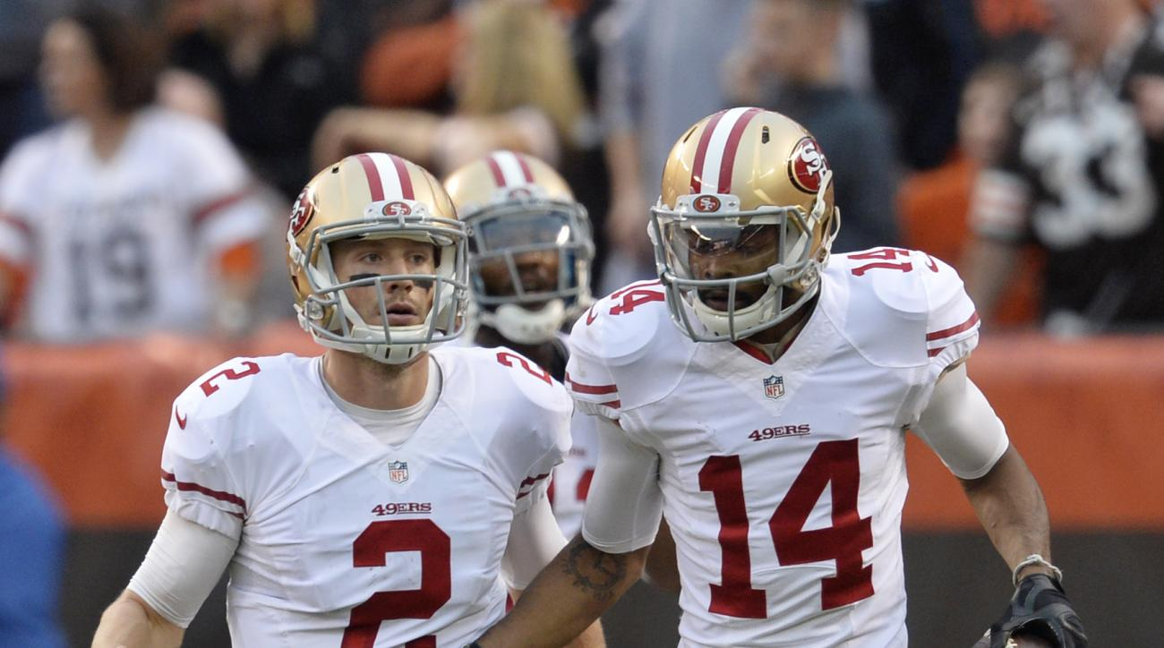 San Francisco 49ers quarterback Blaine Gabbert (2) and wide receiver Jerome Simpson (14) celebrate a touchdown during the second half of an NFL football game against the Cleveland Browns, Sunday, Dec. 13, 2015, in Cleveland. Simpson caught a six-yard pass