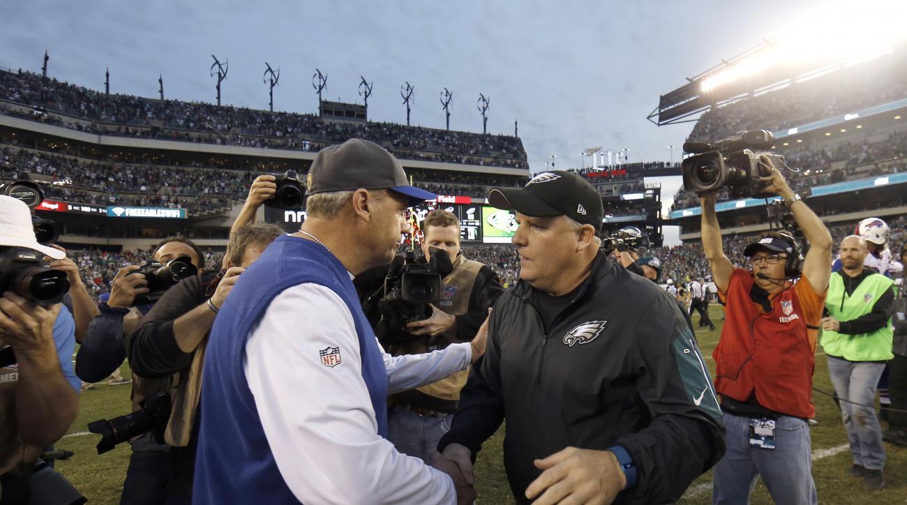 Philadelphia Eagles' Chip Kelly, right, and Buffalo Bills' Rex Ryan, left, meet after an NFL football game, Sunday, Dec. 13, 2015, in Philadelphia. Philadelphia won 23-20. (AP Photo/Michael Perez)
