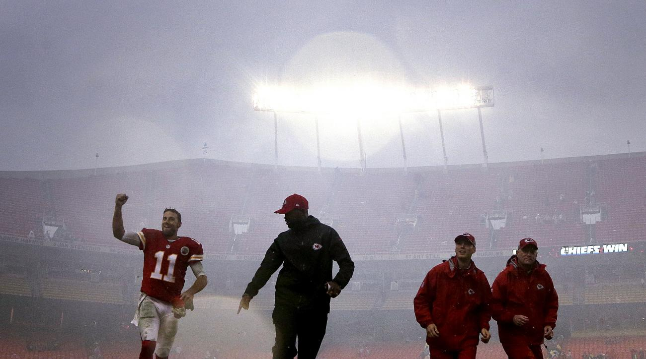 Kansas City Chiefs quarterback Alex Smith (11) runs off the field after an NFL football game against the San Diego Chargers, Sunday, Dec. 13, 2015, in Kansas City, Mo. The Chiefs won 10-3. (AP Photo/Charlie Riedel)