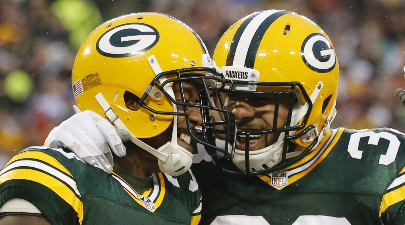 Green Bay Packers' Sam Shields (37) celebrates his interception with teammate Micah Hyde (33) during the first half of an NFL football game against the Dallas Cowboys Sunday, Dec. 13, 2015, in Green Bay, Wis. (AP Photo/Jeffrey Phelps)
