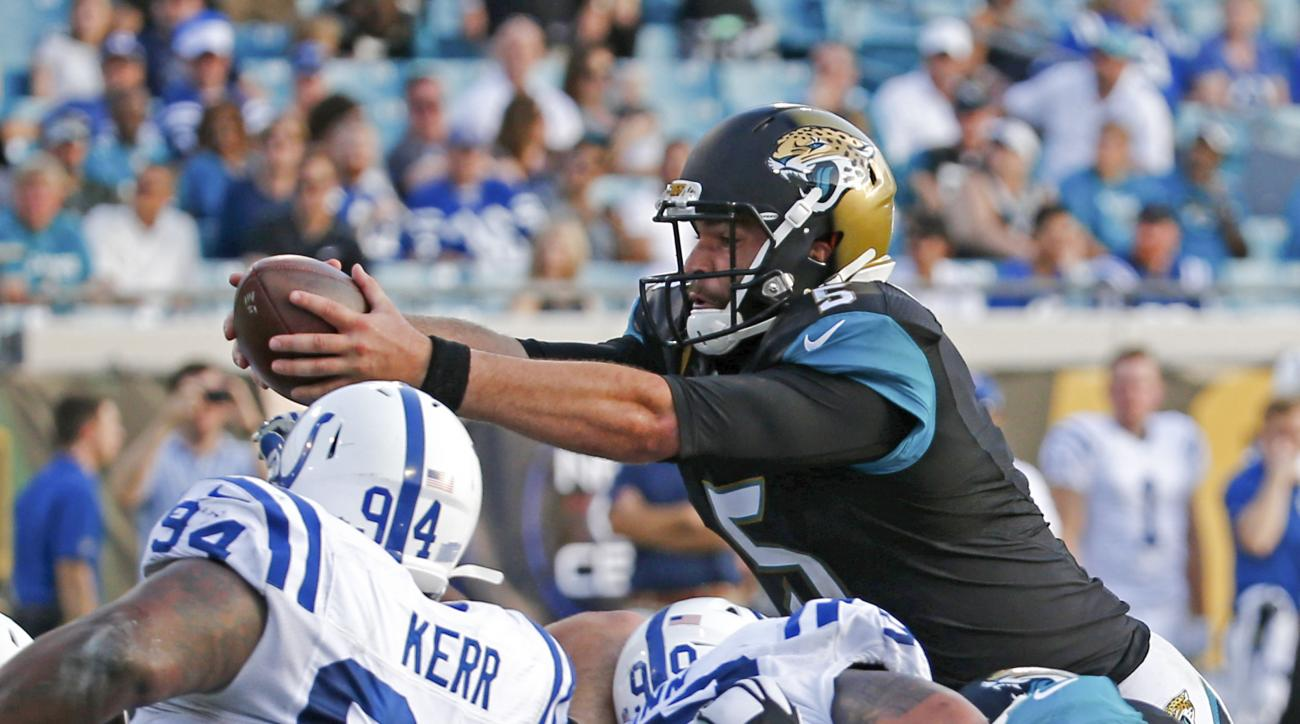 Jacksonville Jaguars quarterback Blake Bortles, top right, dives over the Indianapolis Colts line for a touchdown during the second half of an NFL football game in Jacksonville, Fla., Sunday, Dec. 13, 2015. Jacksonville won 51-16. (AP Photo/Stephen B. Mor