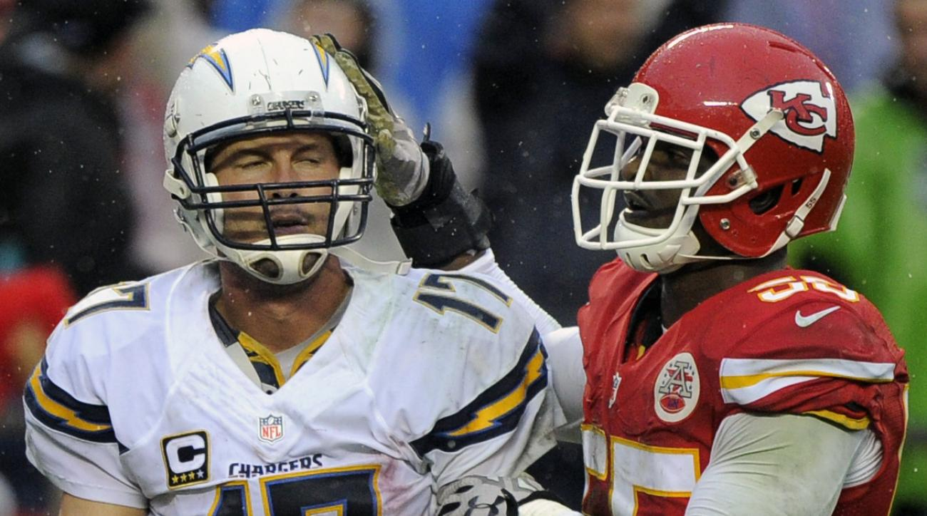 Kansas City Chiefs linebacker Dee Ford (55) pats San Diego Chargers quarterback Philip Rivers (17) on the helmet after sacking him during the second half of an NFL football game in Kansas City, Mo., Sunday, Dec. 13, 2015. The Chiefs won 10-3. (AP Photo/Ed