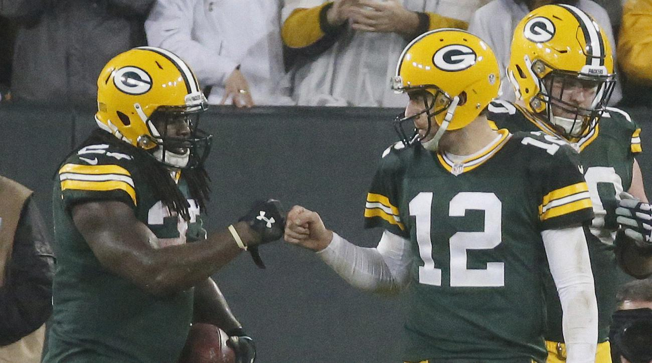 Green Bay Packers' Eddie Lacy is congratulated by Aaron Rodgers (12) after Lacy's touchdown run during the second half of an NFL football game against the Dallas Cowboys Sunday, Dec. 13, 2015, in Green Bay, Wis. (AP Photo/Mike Roemer)