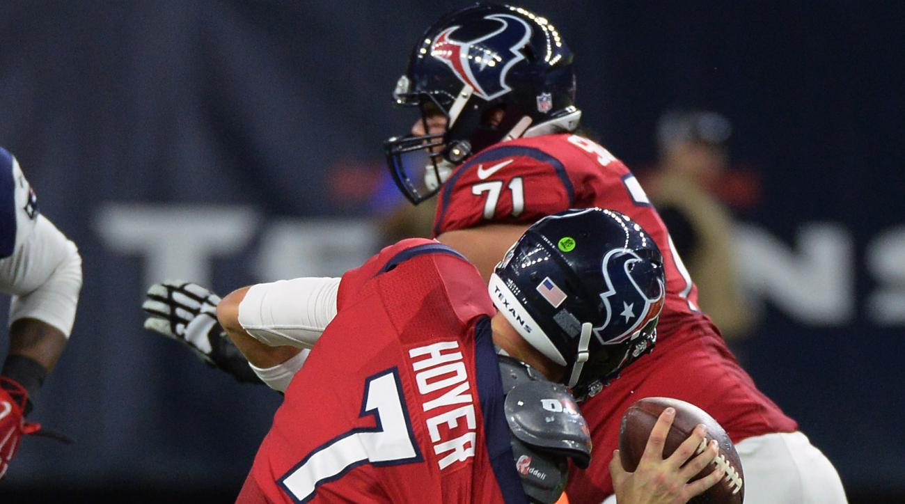 Houston Texans quarterback Brian Hoyer (7) is sacked by New England Patriots defensive end Akiem Hicks (72) during the second half of an NFL football game Sunday,  Dec. 13, 2015, in Houston. Hoyer was injured on the play and left the game. (AP Photo/Georg
