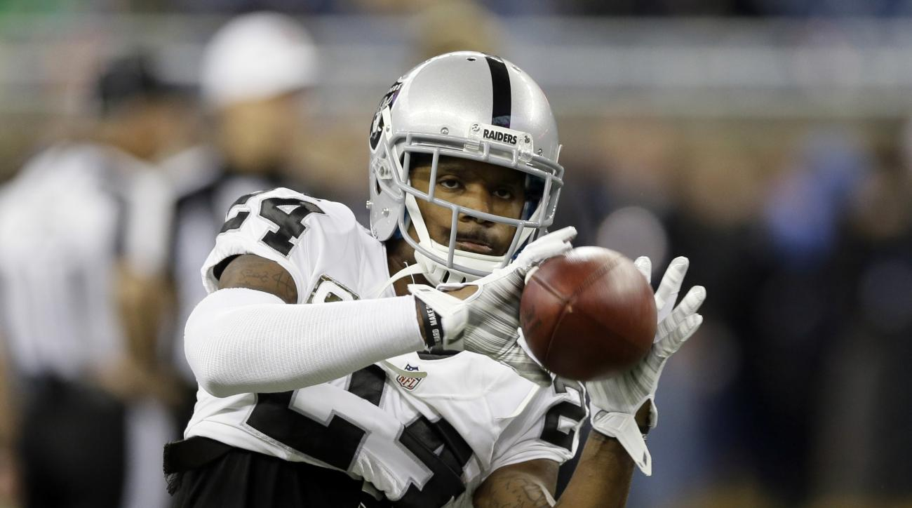 FILE - In this Nov. 22, 2015, file photo, Oakland Raiders free safety Charles Woodson (24) catches during warmups before an NFL football game against the Detroit Lions, in Detroit. The eight finalists for the second annual Art Rooney Sportsmanship Award h