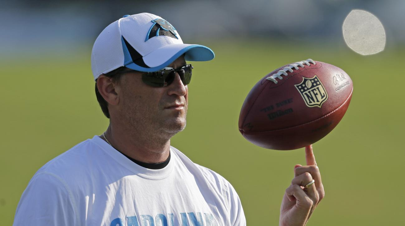 File-This July 26, 2013, file photo shows Carolina Panthers offensive coordinator Mike Shula spinning a football on his finger during practice at NFL football training camp in Spartanburg, S.C. Hall of Fame coach Don Shula is rooting for his son Mike and