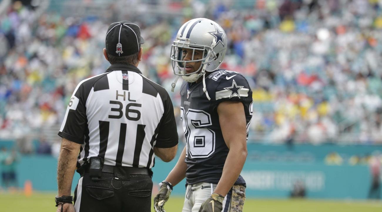 Dallas Cowboys defensive back Tyler Patmon (26) talks to head lineman Tony Veteri (36) during the first half of an NFL football game against the Miami Dolphins, Sunday, Nov. 22, 2015, in Miami Gardens, Fla.  (AP Photo/Lynne Sladky)