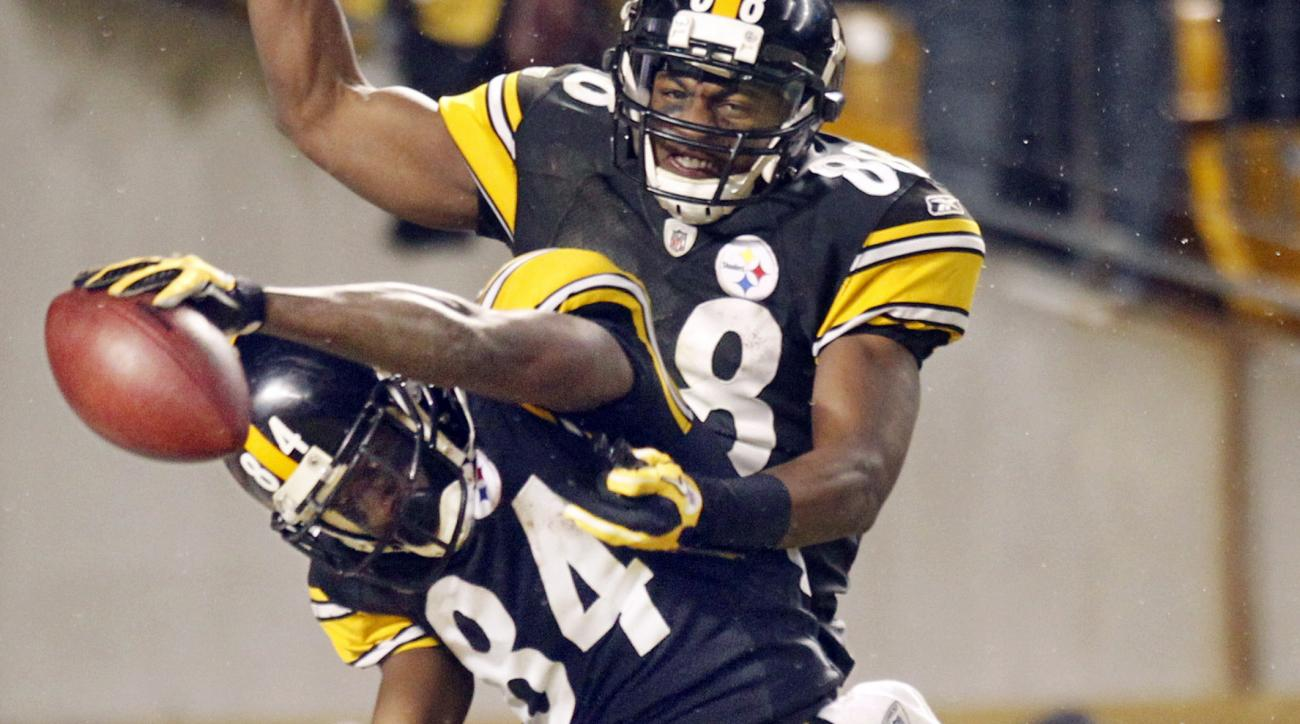 FILE-- In this file photo from Jan. 15, 2011, Pittsburgh Steelers wide receiver Antonio Brown (84) celebrates with Emmanuel Sanders after Brown's long pass reception during an NFL divisional football playoff game against the Baltimore Ravens in Pittsburgh