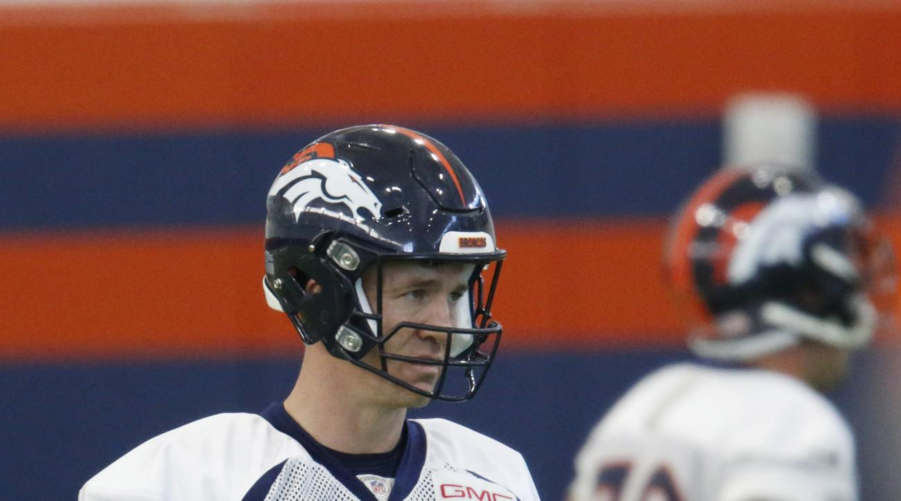 Denver Broncos quarterback Peyton Manning warms up during a practice at the team's headquarters Wednesday, Dec.16, 2015, in Englewood, Colo. (AP Photo/David Zalubowski)