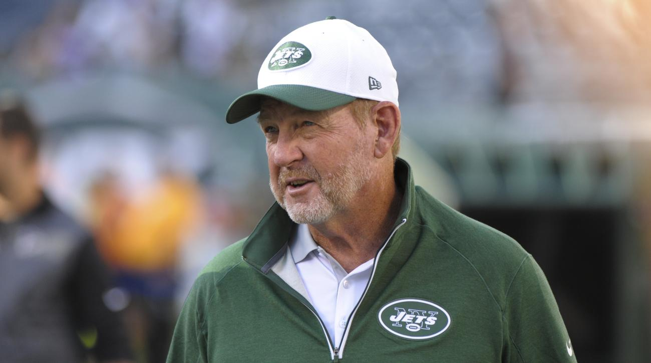 FILE - In this Aug. 21, 2015, file photo, New York Jets offensive coordinator Chan Gailey watches his team warm up for an NFL preseason football game against the Atlanta Falcons in in New York. Quarterback Ryan Fitzpatrick is having a career year, Brandon