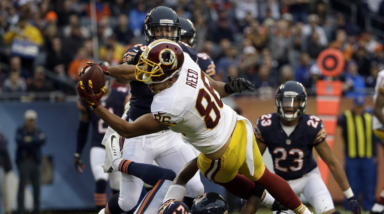 FILE - In this Dec. 13, 2015 file photo, Washington Redskins tight end Jordan Reed (86) dives to the end zone, but the initial call of a touchdown was reversed by an official during the first half of an NFL football game against the Chicago Bears in Chica
