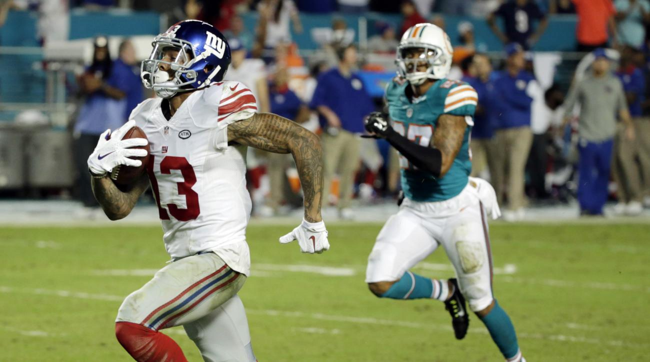 FILE - In this Dec. 14, 2015, file photo, New York Giants wide receiver Odell Beckham (13) runs for a touchdown during the second half of an NFL football gam against the Miami Dolphins, in Miami Gardens, Fla. The 13-0 Panthers take on the New York Giants