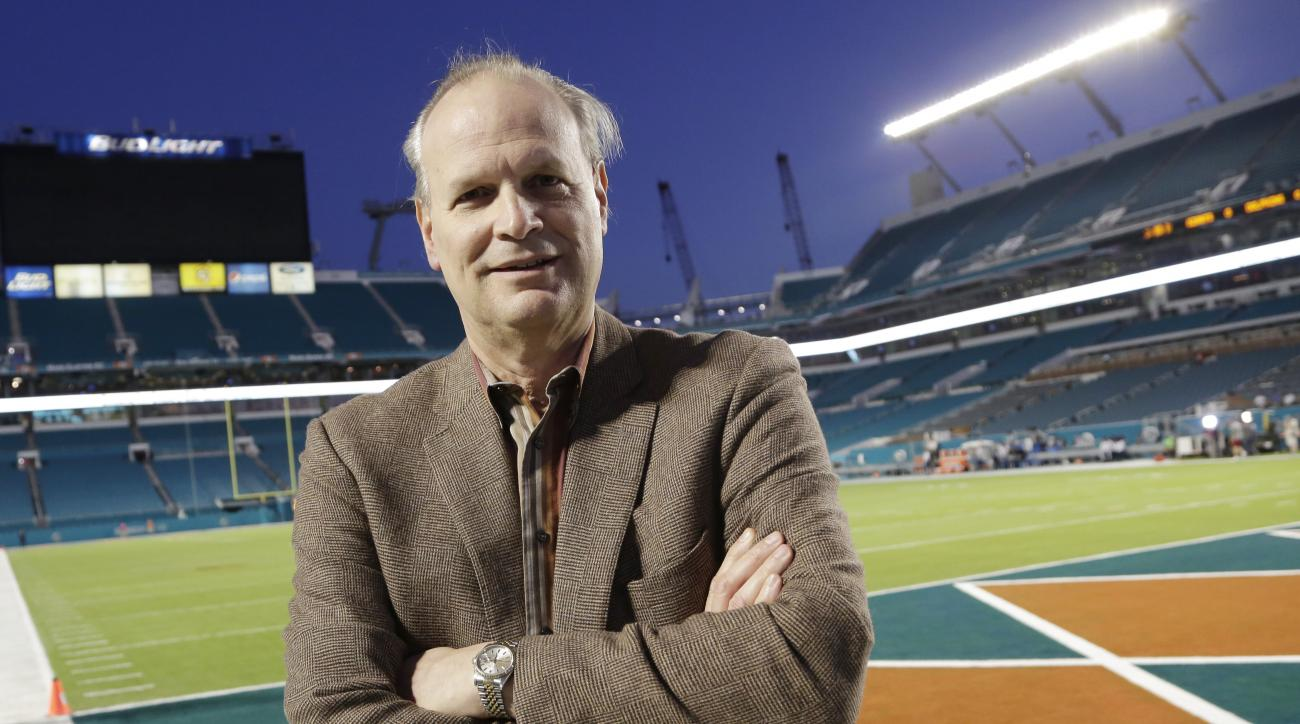 In this Dec. 14, 2015,  photo, Steve Hirdt is seen at his 501st Monday night football game,  between the Miami Dolphins and the New York Giants,  in Miami Gardens, Fla. Hirdt is the statistical eyes and ears of the operation, a walking encyclopedia of sor