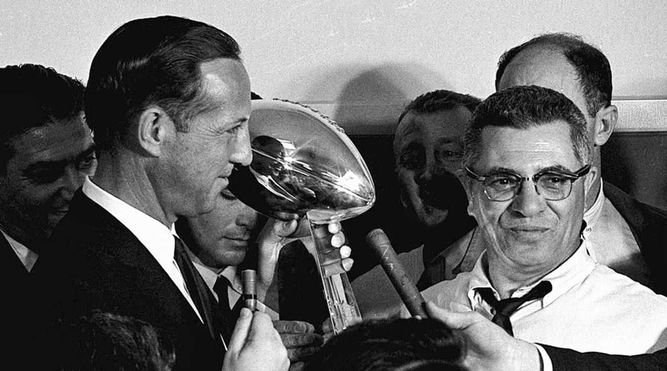 FILE - In this Jan. 15, 1967,  file photo, football commissioner Pete Rozelle, left, presents the trophy to Green Bay Packers coach Vince Lombardi after they beat the Kansas City Chiefs 35-10 in Super Bowl I in Los Angeles.  (AP Photo, File)