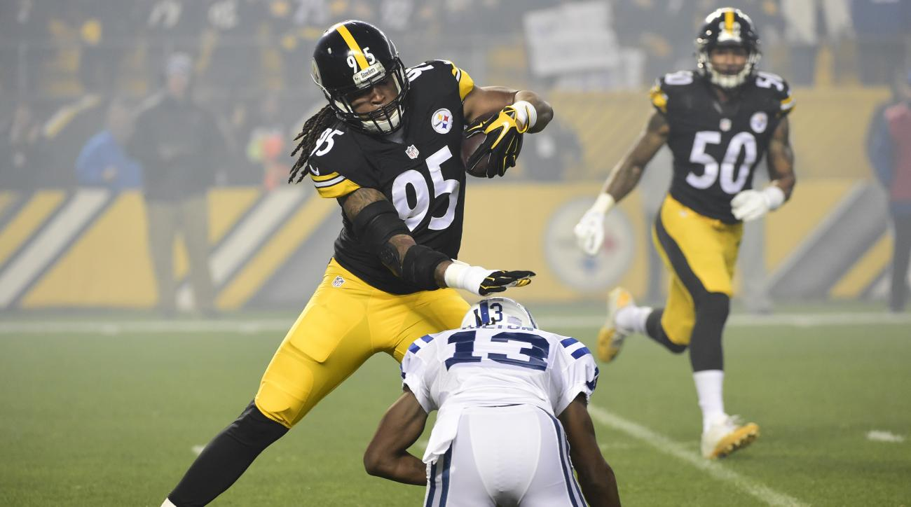 FILE - This Dec. 6, 2015 file photo shows Pittsburgh Steelers outside linebacker Jarvis Jones (95) running with the ball after making an interception in the first quarter of an NFL football game against the Indianapolis Colts in Pittsburgh. The Pittsburgh