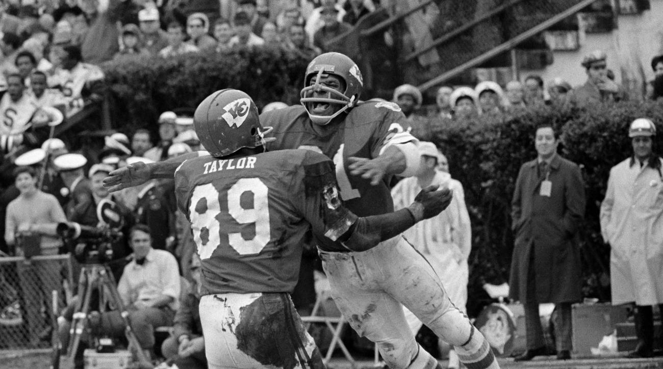 FILE - In this Jan. 11, 1970, file photo, Kansas City Chiefs running back Mike Garrett, right, celebrates with Otis Taylor after scoring a touchdown on a 5-yard run in the second quarter of Super Bowl IV against the Minnesota Vikings in New Orleans. The C