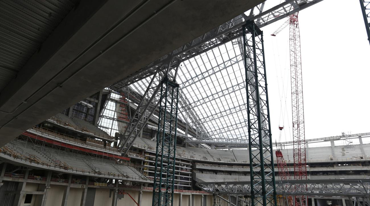 In this photo taken Thursday, July 16, 2015 file photo,  openings for the see-through, lightweight EFTE roof panels are shown at the new Minnesota Vikings NFL football stadium that is under construction in Minneapolis.  The Vikings have won approval to co