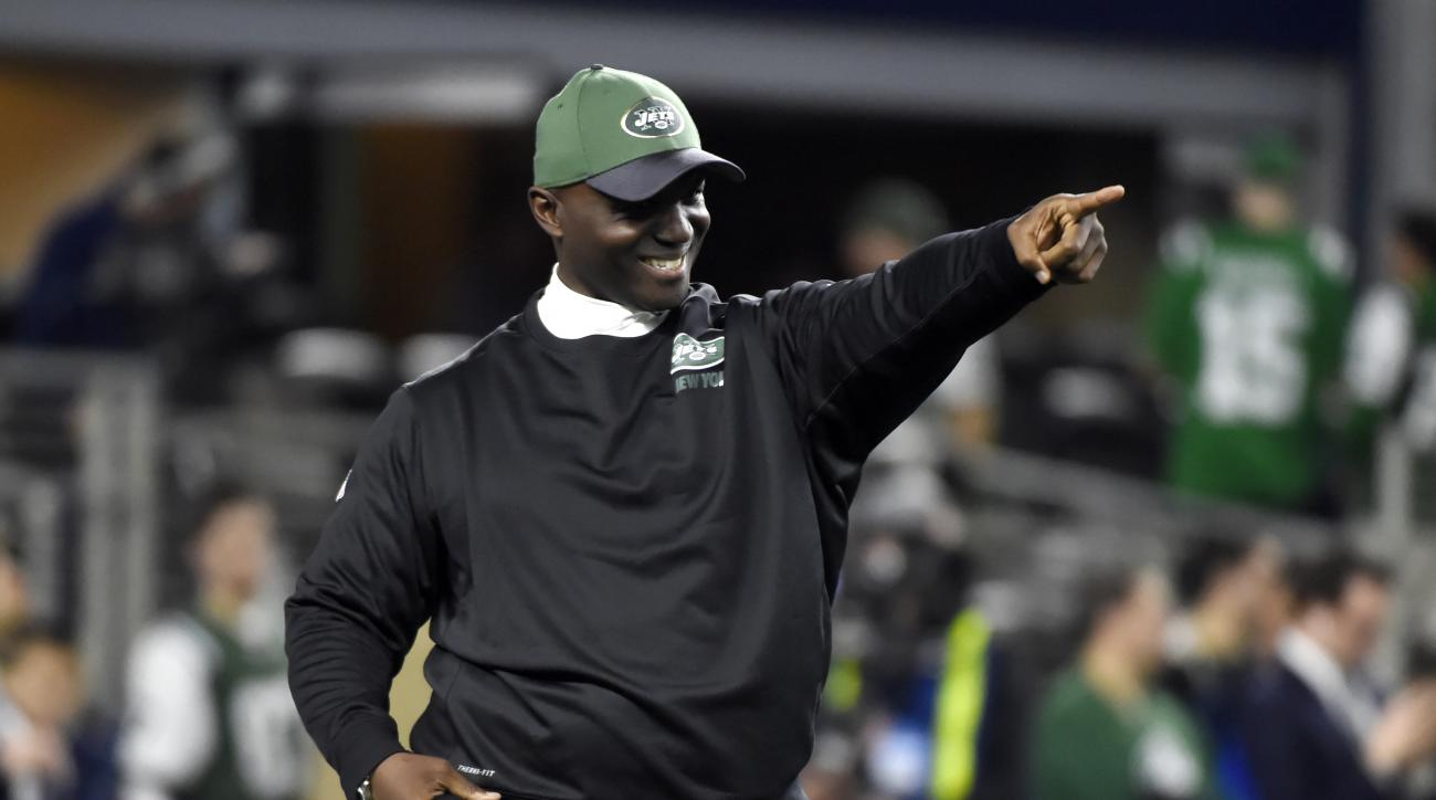 New York Jets coach Todd Bowles points as he stands on the field watching his team warm up before an NFL football game against the Dallas Cowboys on Saturday, Dec. 19, 2015, in Arlington, Texas. (AP Photo/Michael Ainsworth)