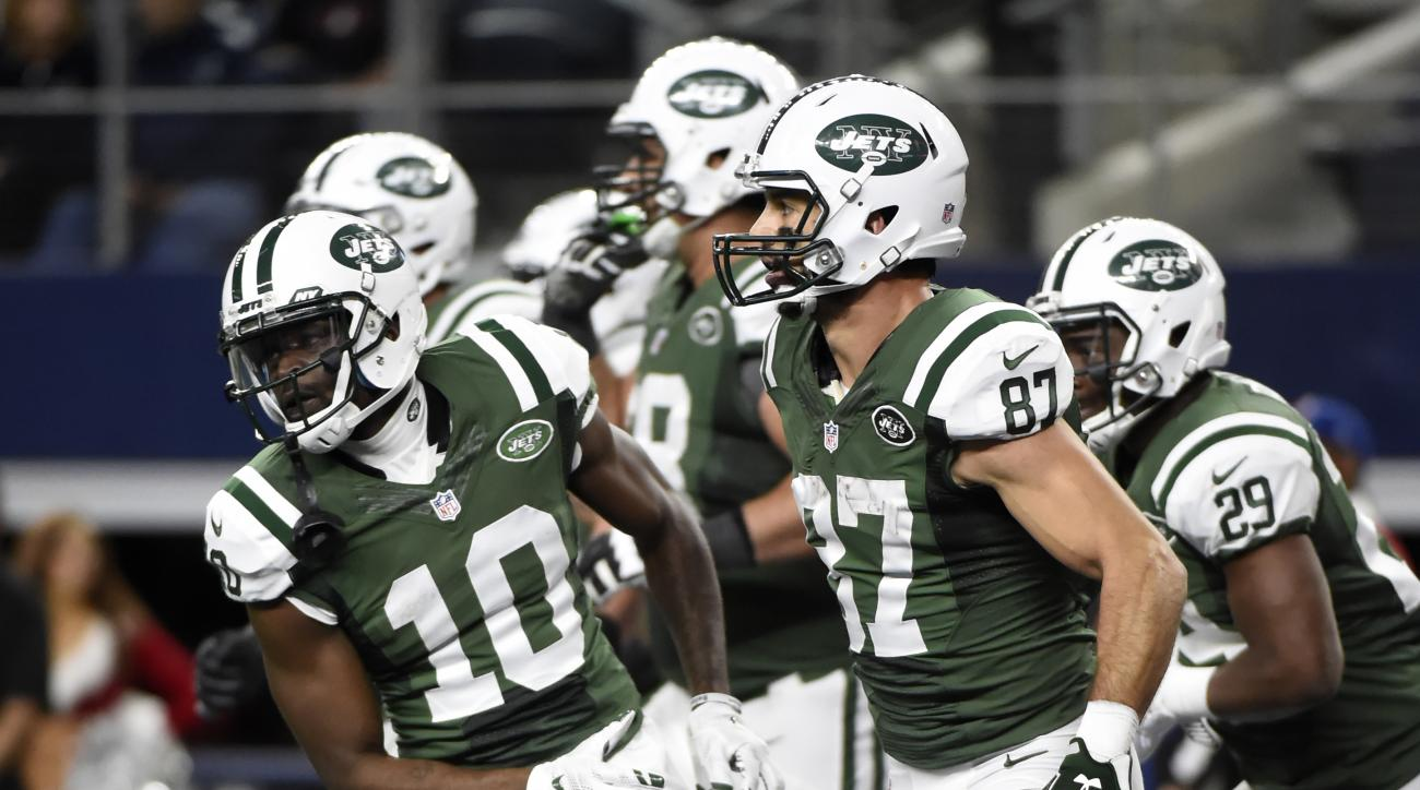 New York Jets' Kenbrell Thompkins (10) celebrates with Eric Decker (87) after Decker's  catch for a touchdown against the Dallas Cowboys in the second half of an NFL football game, Saturday, Dec. 19, 2015, in Arlington, Texas. (AP Photo/Michael Ainsworth)