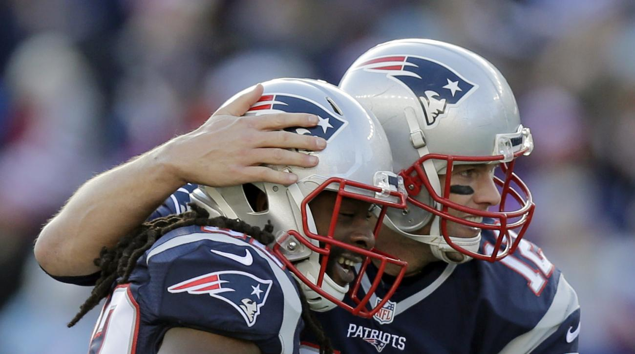 New England Patriots quarterback Tom Brady (12) celebrates with wide receiver Keshawn Martin (82) after throwing a touchdown pass to running back James White in the first half of an NFL football game against the Tennessee Titans, Sunday, Dec. 20, 2015, in