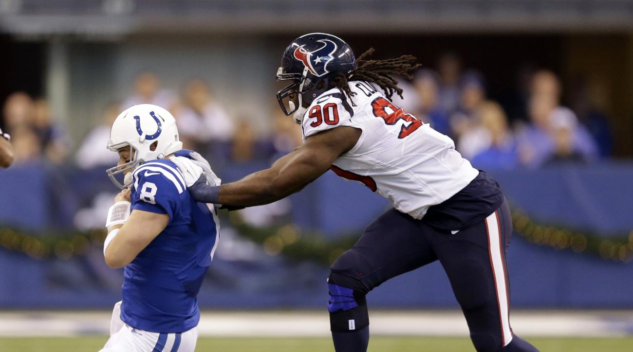 Indianapolis Colts' Matt Hasselbeck (8) is pushed out of bounds by Houston Texans' Jadeveon Clowney (90) during the first half of an NFL football game Sunday, Dec. 20, 2015, in Indianapolis. (AP Photo/Michael Conroy)