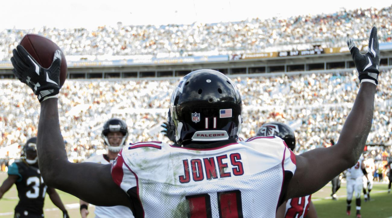 Atlanta Falcons wide receiver Julio Jones (11) celebrates his touchdown against the Jacksonville Jaguars during the first half of an NFL football game, Sunday, Dec. 20, 2015, in Jacksonville, Fla. (AP Photo/Stephen B. Morton)