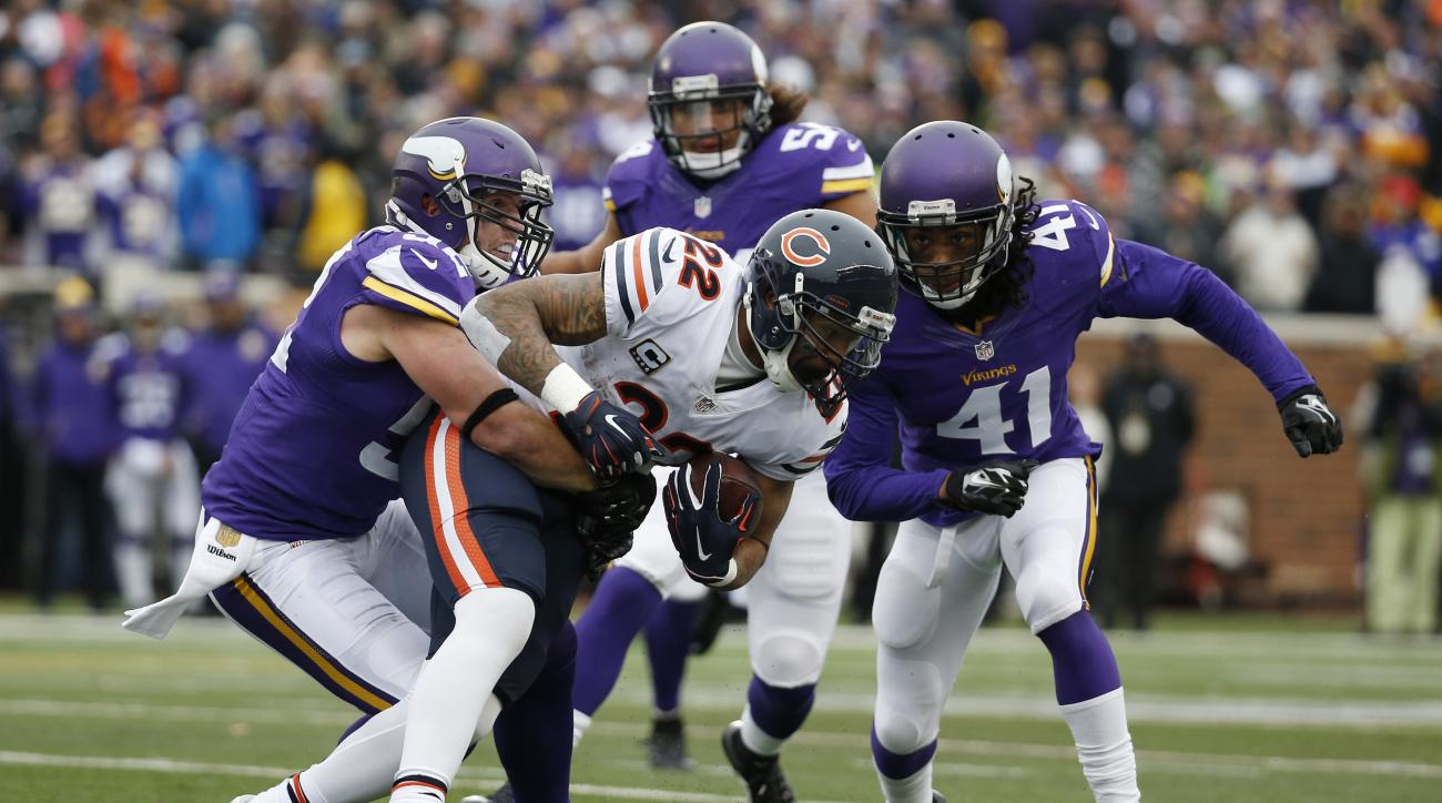 Chicago Bears running back Matt Forte (22) is tackled by Minnesota Vikings outside linebacker Chad Greenway, left, and strong safety Anthony Harris (41) during the second half of an NFL football game, Sunday, Dec. 20, 2015, in Minneapolis. (AP Photo/Alex