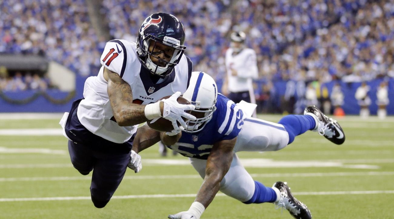 Houston Texans' Jaelen Strong (11) dives into the end zone for a 8-yard touchdown reception during the second half of an NFL football game against the Indianapolis Colts, Sunday, Dec. 20, 2015, in Indianapolis. Colts' D'Qwell Jackson (52) defends on the p