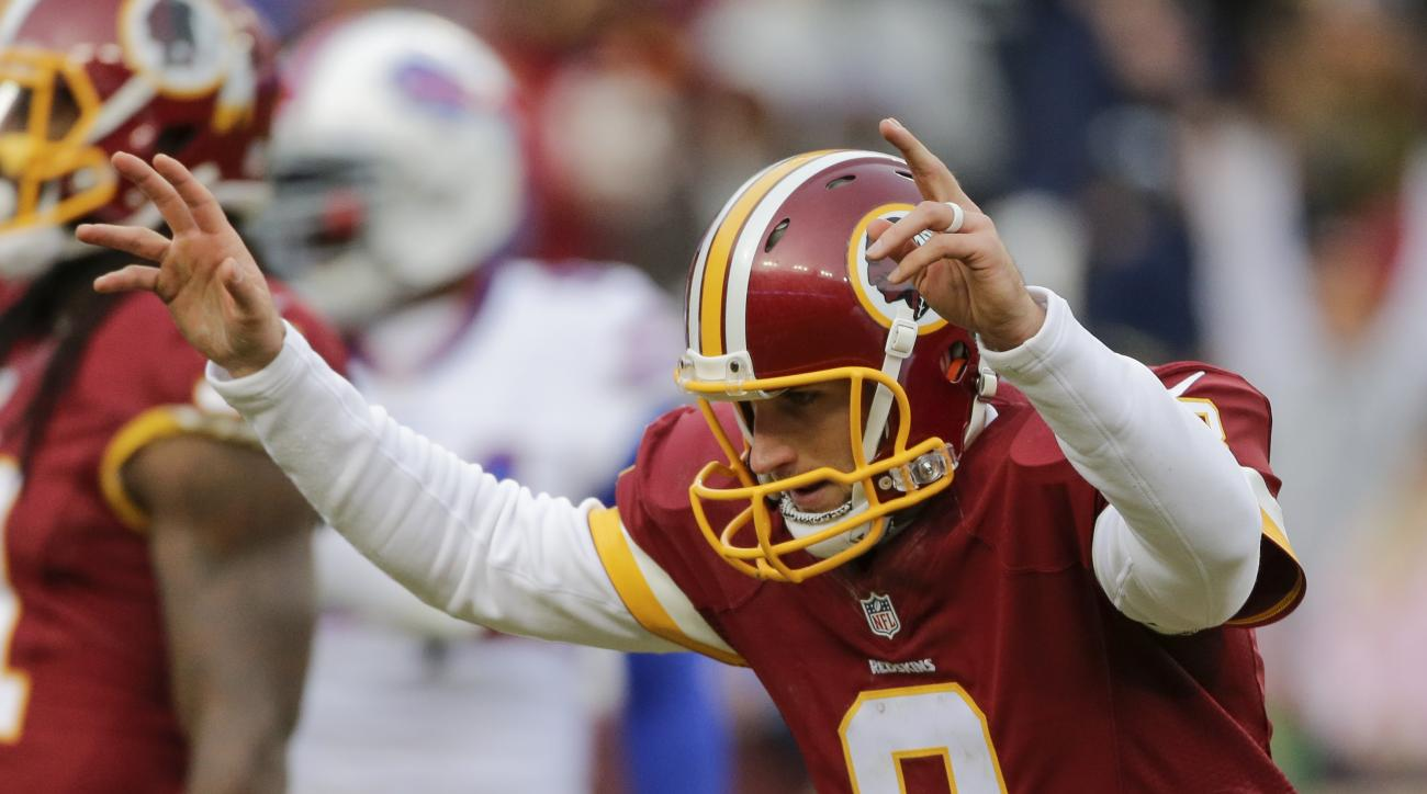 Washington Redskins quarterback Kirk Cousins (8) celebrates wide receiver Pierre Garcon's touchdown during the second half of an NFL football game against the Buffalo Bills in Landover, Md., Sunday, Dec. 20, 2015. (AP Photo/Mark Tenally)