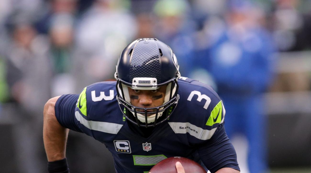 Seattle Seahawks quarterback Russell Wilson runs with the ball against the Cleveland Browns in the first half of an NFL football game, Sunday, Dec. 20, 2015, in Seattle. (AP Photo/Scott Eklund)