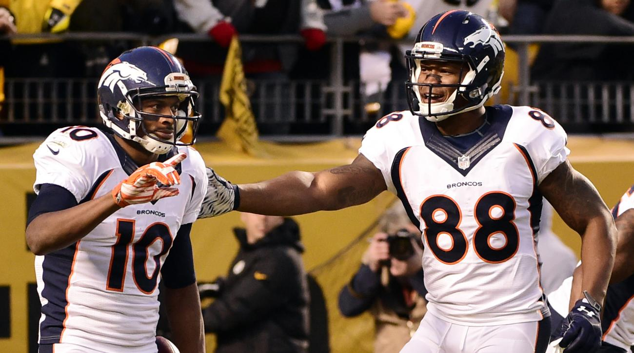 Denver Broncos wide receiver Emmanuel Sanders (10) celebrates his touchdown with teammate Demaryius Thomas (88) during the first half of an NFL football game against the Pittsburgh Steelers in Pittsburgh, Sunday, Dec. 20, 2015. (AP Photo/Fred Vuich)