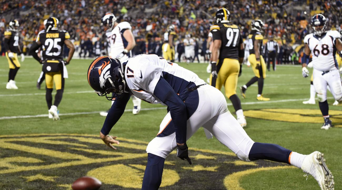 Denver Broncos quarterback Brock Osweiler (17) celebrates after running for a touchdown during the first half of an NFL football game in Pittsburgh, Sunday, Dec. 20, 2015. (AP Photo/Fred Vuich)