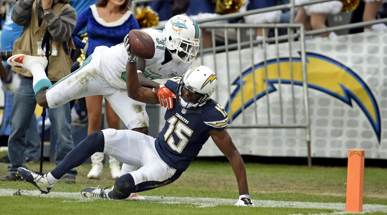 San Diego Chargers wide receiver Dontrelle Inman, right, is tackled by Miami Dolphins free safety Michael Thomas during the first half in an NFL football game Sunday, Dec. 20, 2015, in San Diego. (AP Photo/Denis Poroy)