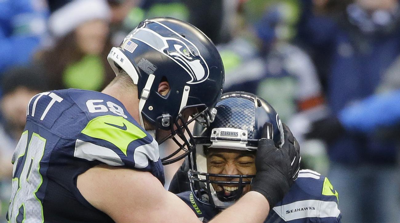 Seattle Seahawks' Tyler Lockett (16) is congratulated by Justin Britt after Lockett's touchdown reception against the Cleveland Browns in the second half of an NFL football game, Sunday, Dec. 20, 2015, in Seattle. (AP Photo/Ted S. Warren)