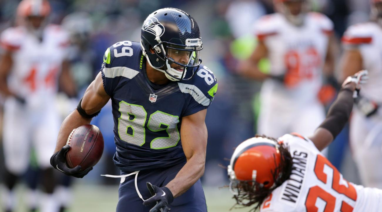 Seattle Seahawks' Doug Baldwin runs with the ball after a pass reception as Cleveland Browns' Tramon Williams falls behind in the second half of an NFL football game, Sunday, Dec. 20, 2015, in Seattle. (AP Photo/Scott Eklund)