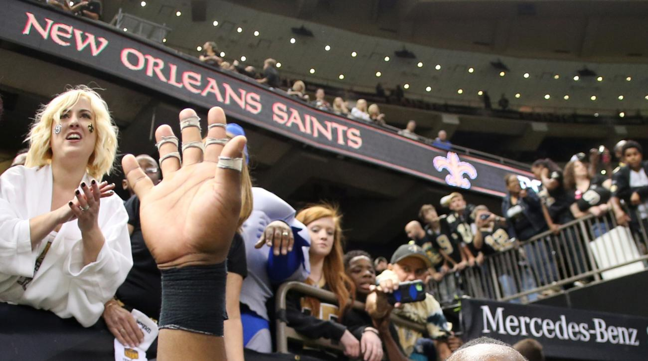 FILE - In this Oct. 15, 2015, file photo, New Orleans Saints cornerback Delvin Breaux (40) waves to fans after the second half of an NFL football game against the Atlanta Falcons in New Orleans. Even though the Saints' season hasn't gone as head coach Sea