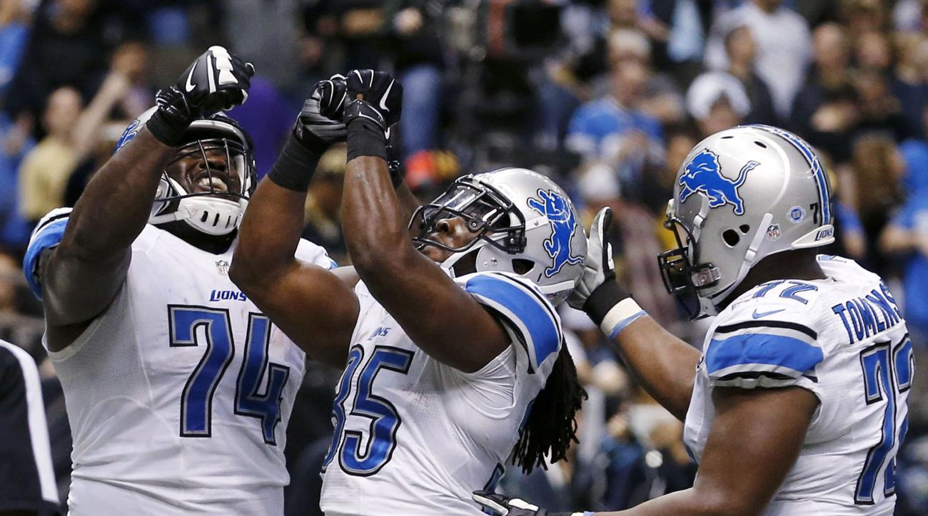 Detroit Lions running back Joique Bell (35) celebrates his touchdown in the second half of an NFL football game against the New Orleans Saints in New Orleans, Monday, Dec. 21, 2015. (AP Photo/Jonathan Bachman)